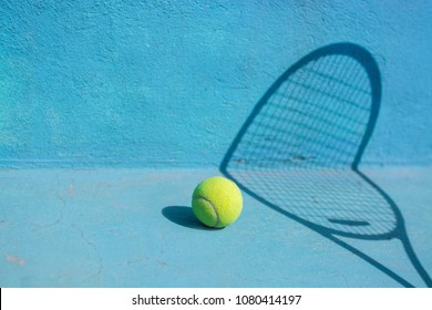 Tennis ball and racket on blue court.Sport Concept.