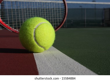 Tennis ball and racquet on the court