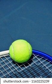 Tennis ball sitting on a racquet, room for your text.