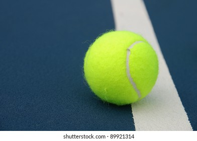 Tennis ball touching the line.