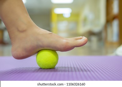 The Tennis Ball Treatment : The ball will apply pressure to the painful spot and raise the procedure. It's effective, but you need to give it time to work. Image with copy space