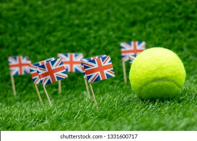 Tennis ball with Union Jack Flag on green grass