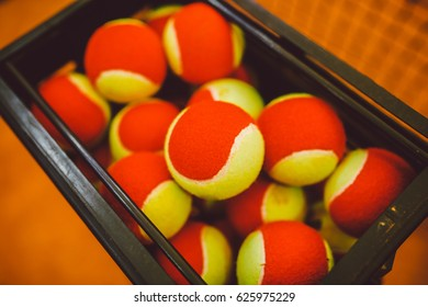 a lot of tennis balls to basket balls, tennis court clay. Grid for tennis