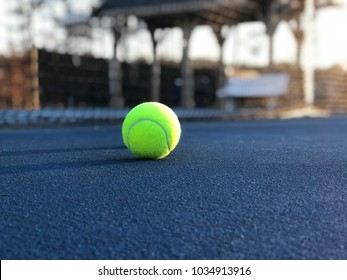 Tennis Balls On Blue Tennis Court By Net Low Angle
