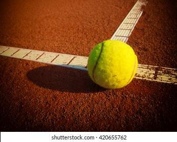 Tennis balls on a tennis clay court