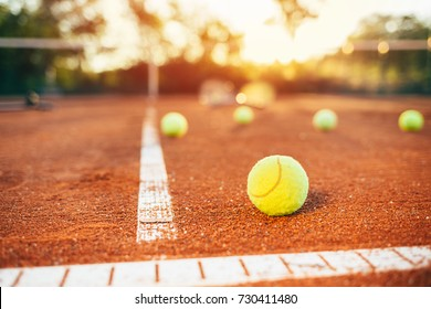 Tennis balls on clay court. Tennis ball in the field of tennis court