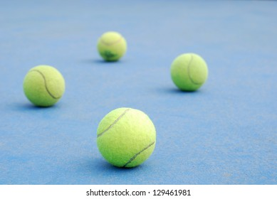 tennis balls on court field