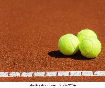 Tennis balls on a tennis court.Shallow doff, copy space