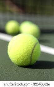 Tennis balls on green court