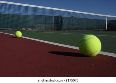 Tennis balls on a green & red court