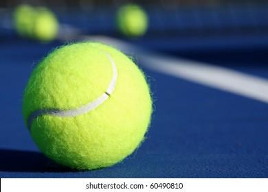 Tennis Balls on a Modern Blue Court