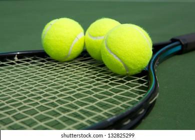 Tennis Balls on a Racket Close Up