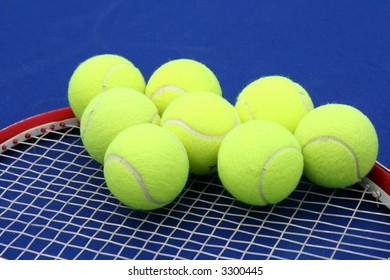 Tennis balls on a racquet