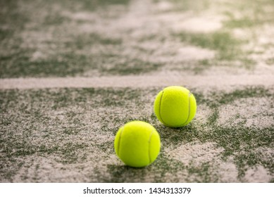 Tennis Balls in a Padel Court Outdoors. Padel Balls on the Floor in a Padel Court. Sport Concept.