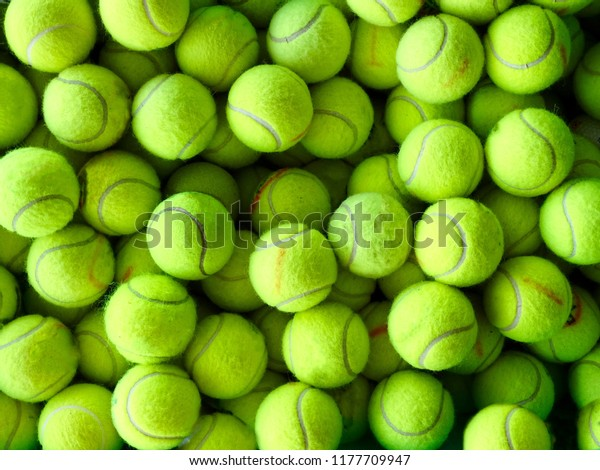 Tennis balls for practice, background. Second-hand Tennis balls. Used Tennis balls.