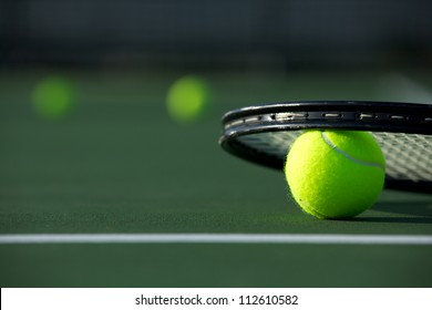 Tennis Balls and a Racket on the Court with room for copy