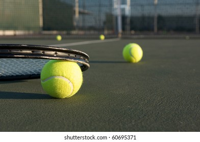 Tennis Balls and Racket on the Court