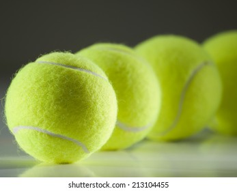 tennis balls in the row ,for tennis,recreation and sport themes