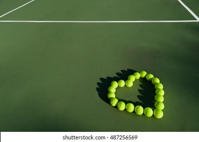 Tennis balls in shape of heart