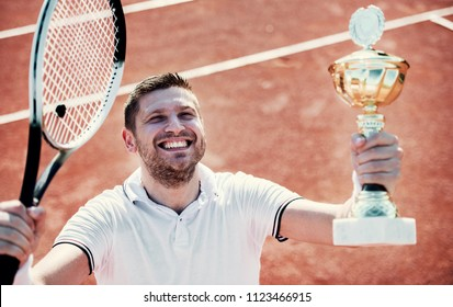 Tennis champion. Winner of the tournament holding cup in a hand. Sport, recreation concept