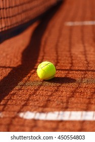 tennis court with tennis ball and antuka background.