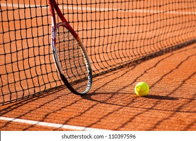 tennis court with tennis ball and racket