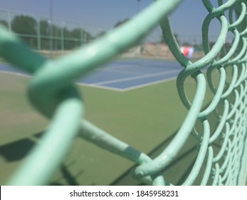 tennis court behind the strings