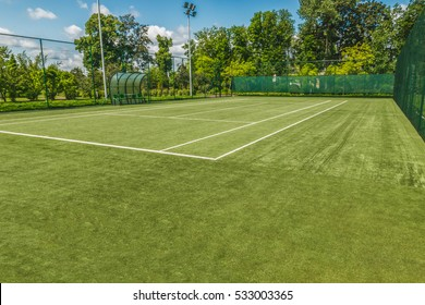 Tennis court in the landscaped park.