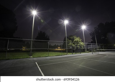 Tennis court lit up at night time