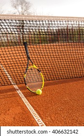 Tennis court with a racket and ball on it