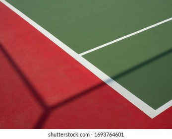Tennis court : right corner court line with casted fence shadow