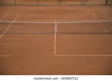 a tennis court with slag