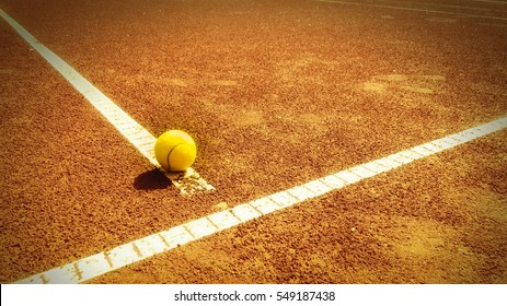 tennis court t-line with ball, outside