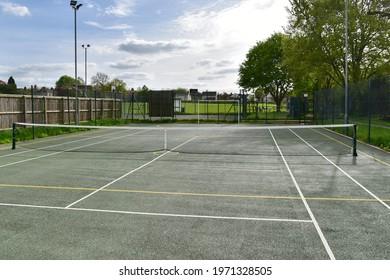 Tennis Court in a Town Park