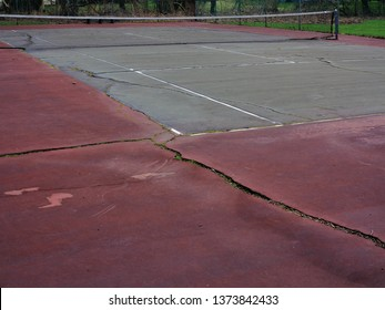 Tennis Courts - Neglected courts with cracks and debris.