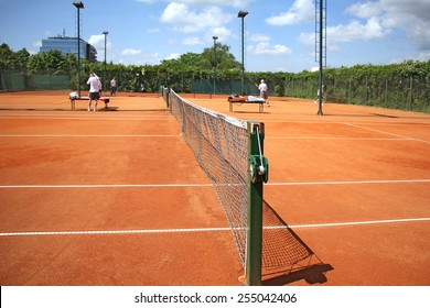 Tennis courts and play pairs, on a nice sunny day