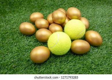 Tennis Easter with tennis ball and golf\den egg on green grass