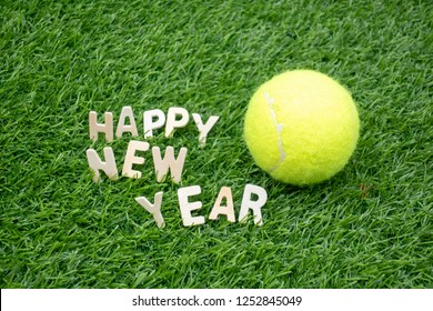 Tennis Happy New Year on green grass background