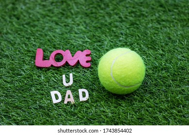 Tennis with love you dad on green grass