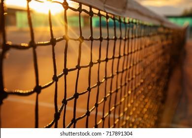 Tennis net on court at sunset