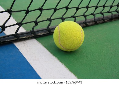tennis on court line with net  ,tennis ball on green blue court and net in sport competition background, sport club concept