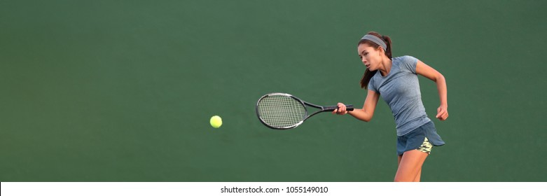 Tennis player Asian woman playing hitting ball on court banner. Copy space panorama crop on green background.