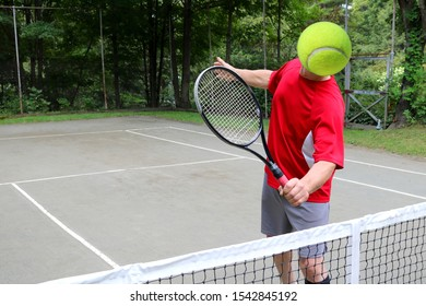 tennis player with a tennis ball head hits a volley