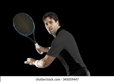 Tennis player with a black shirt, playing on a black background.