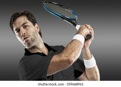 Tennis player with a black shirt, playing on black background.