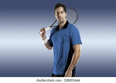 Tennis player with a blue shirt, playing on blue background.
