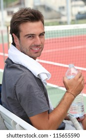 Tennis player with a bottle of water