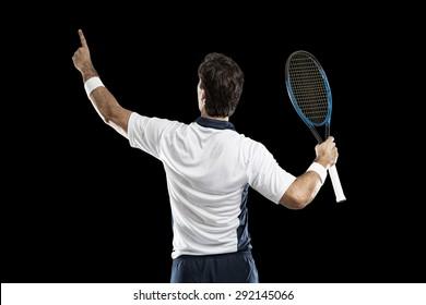 Tennis player celebrating, on a black background.