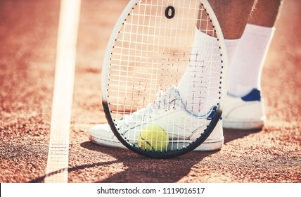 Tennis player, close up photo. Man playing tennis. Sport, recreation concept