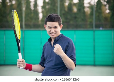 Tennis player expresses his victory in the game - people in tennis match concept